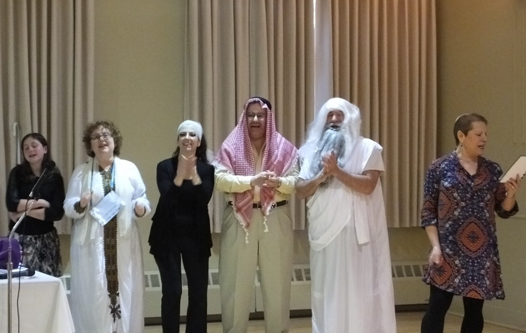 Right to left, Rabbi Amy Small leads the Storahtelling players: Brad Bolnick, Paul Green, Beth Hancock, Barbara Kavadias and Darcy Schleifstein.
